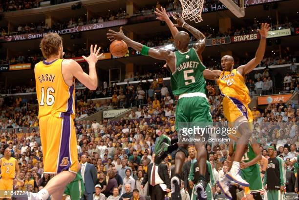 Kobe Bryant of the Los Angeles Lakers passes to teammate Pau Gasol around Kevin Garnett of the Boston Celtics in Game Four of the 2008 NBA Finals at...