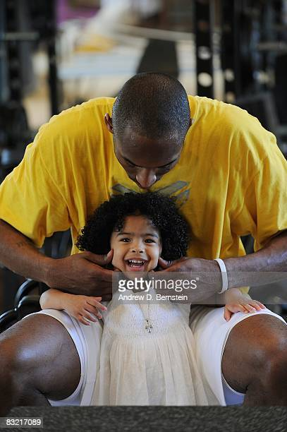 Kobe Bryant of the Los Angeles Lakers pinches his daughter Gianna Bryant's cheeks during a photo session on March 29, 2008 at his home in Newport...
