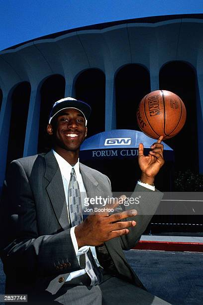 Kobe Bryant of the Los Angeles Lakers poses for a photo at a press conference on July 12 1997 at the Great Western Forum in Inglewood California NOTE...
