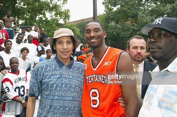 Kobe Bryant of the Los Angeles Lakers poses for a photo with Harlem Playground legend Joe Hammond after playing Summer Playground ball on July 18...