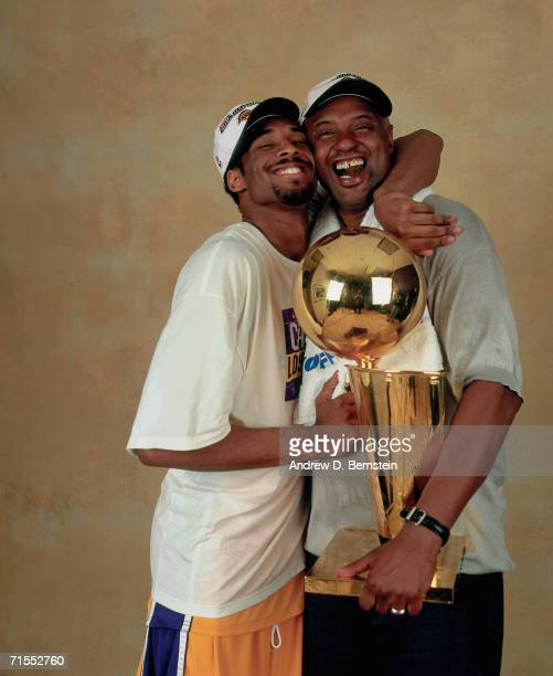 Kobe Bryant of the Los Angeles Lakers poses for a photo with his father Joe Jellybean Bryant after winning the NBA Championship on June 19 2000 at...