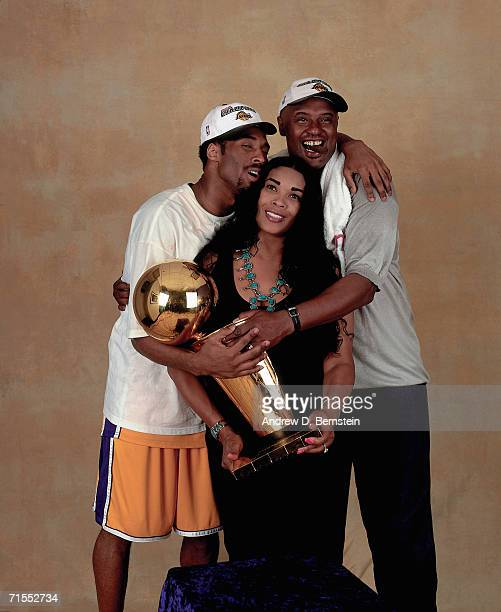 Kobe Bryant of the Los Angeles Lakers poses for a photo with his parents after winning the NBA Championship on June 19, 2000 at the Staples Center in...