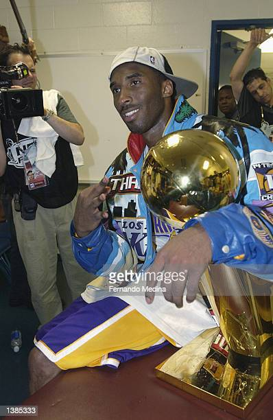 Kobe Bryant of the Los Angeles Lakers poses for a picture with the 2002 NBA Championship Trophy after Game four of the 2002 NBA Finals against the...