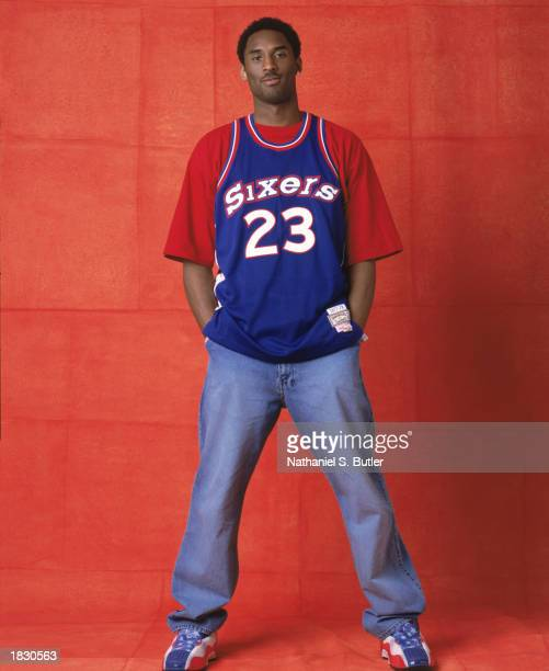 Kobe Bryant of the Los Angeles Lakers poses for a portrait wearing a classic Philadelphia 76ers jersey during the 2002 NBA All-Star Portraits on...