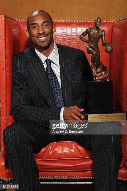 Kobe Bryant of the Los Angeles Lakers poses for a portrait with his MVP trophy during the 200708 NBA Most Valuable Player Award press conference...