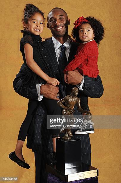 Kobe Bryant of the Los Angeles Lakers poses for a portrait with his daughters Natalia and Gianna at the 200708 NBA Most Valuable Player Award press...
