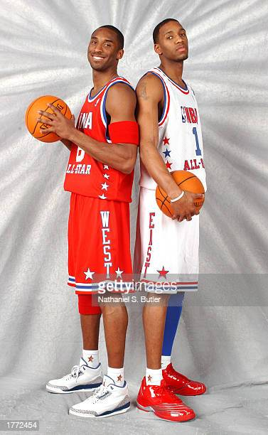Kobe Bryant of the Los Angeles Lakers poses with East Team rival Tracy McGrady for portraits before the NBA AllStar Game on February 9 2003 at the...
