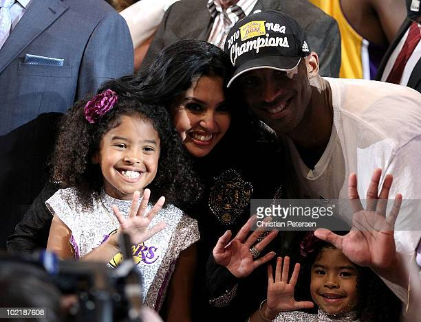 Kobe Bryant of the Los Angeles Lakers poses with his wife and daughters, left to right, Natalia, Vanessa and Gianna, after the Lakers defeated the...