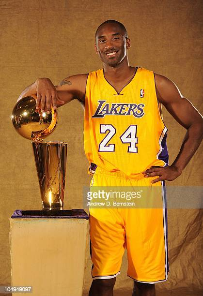 Kobe Bryant of the Los Angeles Lakers poses with the Larry O'Brien Trophy during NBA Media Day at Toyota Sports Center on September 25 2010 in El...