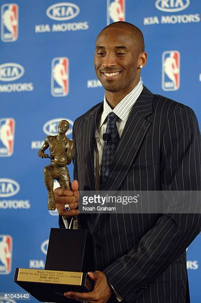 Kobe Bryant of the Los Angeles Lakers poses with the MVP award during the 200708 NBA Most Valuable Player Award press conference presented by Kia...