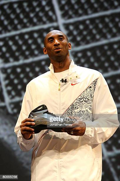 Kobe Bryant of the Los Angeles Lakers poses with the newly unveiled Nike Hyperdunk shoe at the Nike Beijing 08 Innovation Summit on April 7 2008 at...