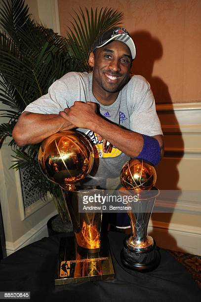 Kobe Bryant of the Los Angeles Lakers poses with the trophy after defeating the Orlando Magic in Game Five of the 2009 NBA Finals at post game party...