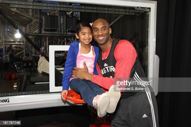Kobe Bryant of the Los Angeles Lakers poses with this daughter during the NBA AllStar Practice in Sprint Arena at Jam Session at Jam Session during...