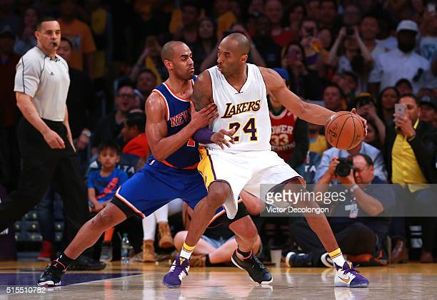 Kobe Bryant of the Los Angeles Lakers posts up Arron Afflalo of the New York Knicks during the second half of their NBA game at Staples Center on...