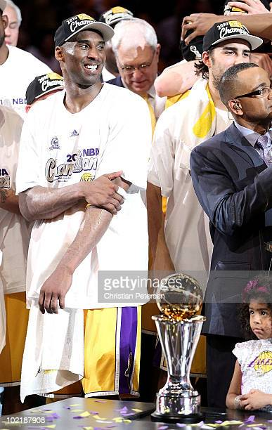 Kobe Bryant of the Los Angeles Lakers prepares to receive the Bill Russell Finals MVP trophy after the Lakers' 83-79 victory against the Boston...