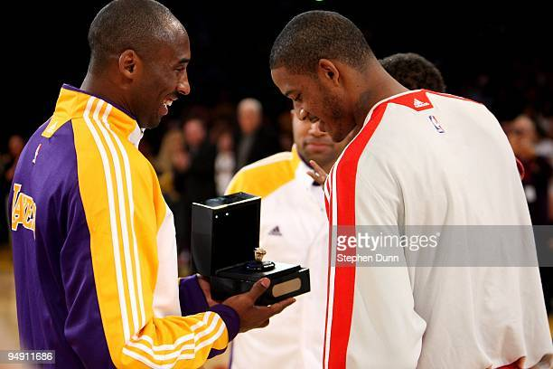 Kobe Bryant of the Los Angeles Lakers presents Trevor Ariza of the Houston Rockets with his 20082009 championship ring he won as a member of the...