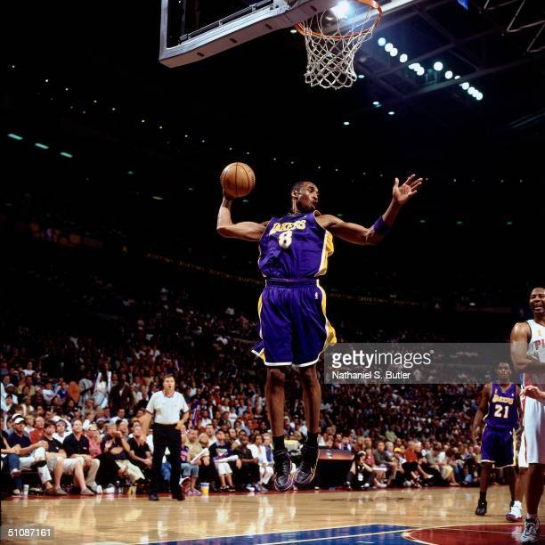 Kobe Bryant of the Los Angeles Lakers pulls down a rebound during Game Five of the 2004 NBA Finals on June 15 2004 at The Palace of Auburn Hills in...