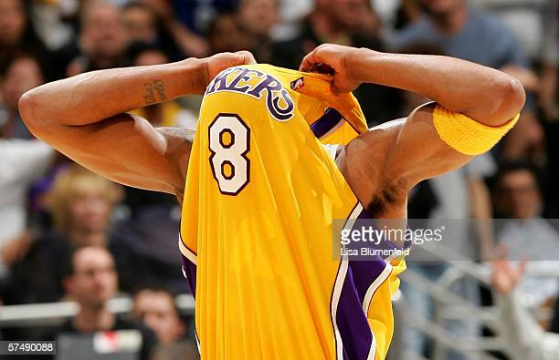 Kobe Bryant of the Los Angeles Lakers pulls his jersey over his head as he reacts after fouling Leandro Barbosa of the Phoenix Suns in the third...