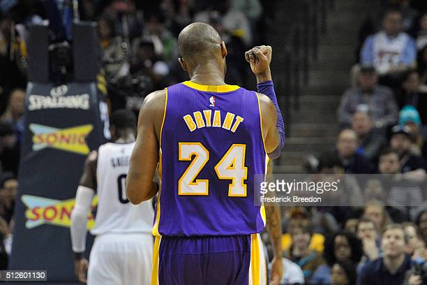 Kobe Bryant of the Los Angeles Lakers pumps his fist during a game against the Memphis Grizzlies at FedExForum on February 24 2016 in Memphis...