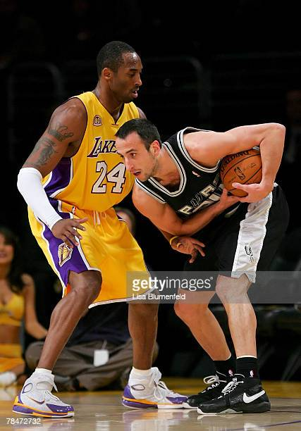 Kobe Bryant of the Los Angeles Lakers puts the pressure on Manu Ginobili of the San Antonio Spurs at Staples Center on December 13 2007 in Los...