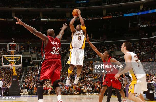 Kobe Bryant of the Los Angeles Lakers puts up a shot against Shaquille O'Neal of the Miami Heat on December 25 2004 at the Staples Center in Los...