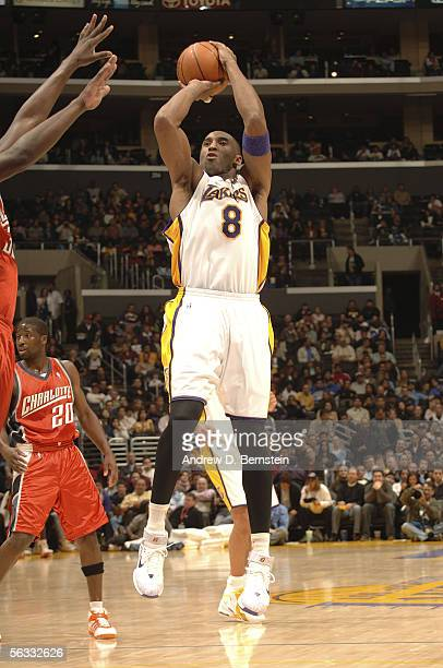 Kobe Bryant of the Los Angeles Lakers puts up a shot against the Charlotte Bobcats on December 4 2005 at Staples Center in Los Angeles California...