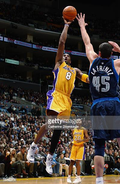 Kobe Bryant of the Los Angeles Lakers puts up a shot over Raef LaFrentz of the Dallas Mavericks during the NBA game at Staples Center on December 6,...