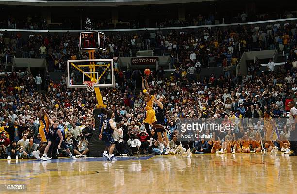 Kobe Bryant of the Los Angeles Lakers puts up a shot that ends up to be the game winner against the Dallas Mavericks during the NBA game at Staples...
