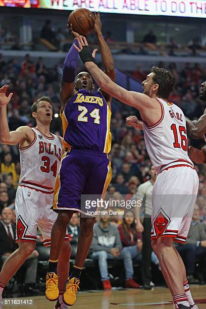 Kobe Bryant of the Los Angeles Lakers puts up shot between Mike Dunleavy and Pau Gasol of the Chicago Bulls at the United Center on February 21 2016...