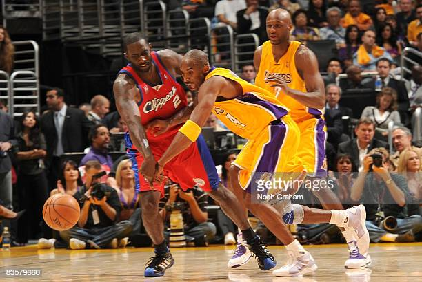 Kobe Bryant of the Los Angeles Lakers reaches for a loose ball against Tim Thomas of the Los Angeles Clippers at Staples Center on November 5 2008 in...