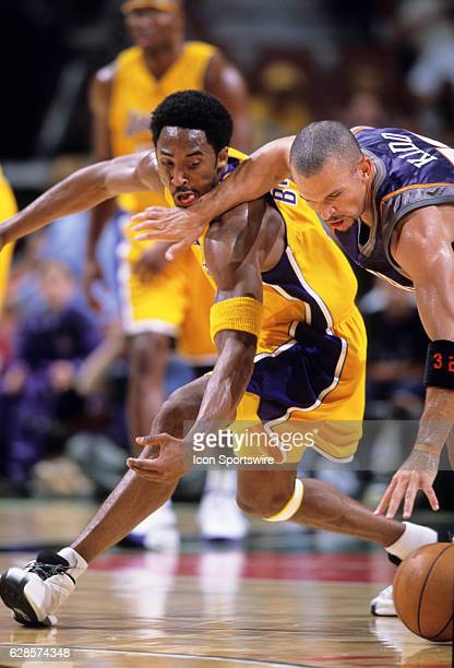 Kobe Bryant of the Los Angeles Lakers reaches for the ball as Jason Kidd of the Phoenix Suns defends defends during a National Basketball Association...