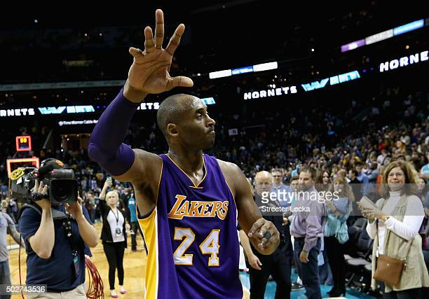 Kobe Bryant of the Los Angeles Lakers reacts after being defeated by the Charlotte Hornets 10898 at Time Warner Cable Arena on December 28 2015 in...