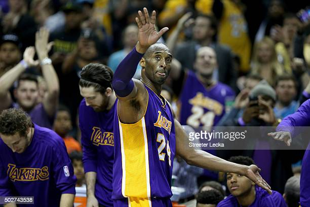 Kobe Bryant of the Los Angeles Lakers reacts after going out of the game as the Charlotte Hornets defeated the Los Angeles Lakers 10898 at Time...