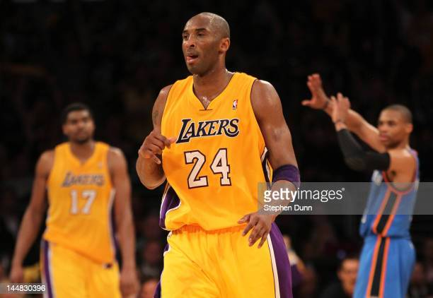 Kobe Bryant of the Los Angeles Lakers reacts after he makes a threepointer as time expires in the third quarter over Russell Westbrook of the...