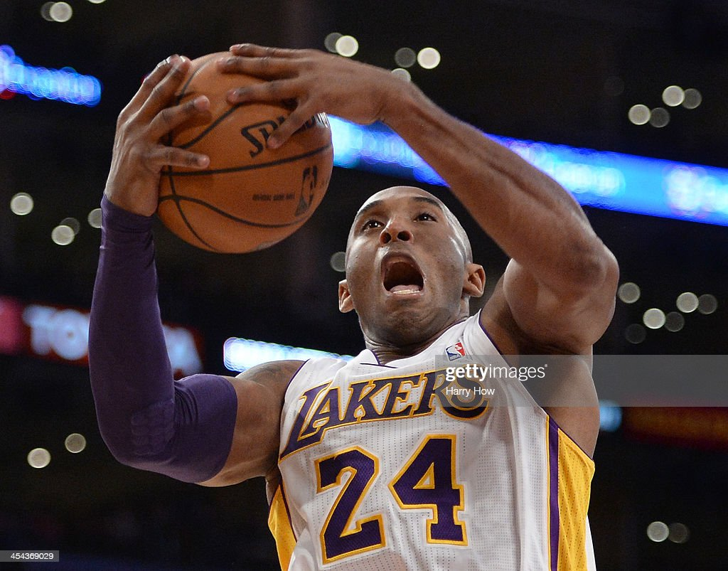 Kobe Bryant #24 of the Los Angeles Lakers reacts as he grabs a rebound during the first half against the Toronto Raptors at Staples Center on December 8, 2013 in Los Angeles, California.