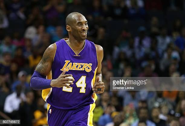 Kobe Bryant of the Los Angeles Lakers reacts as he runs up the court during their game against the Charlotte Hornets at Time Warner Cable Arena on...