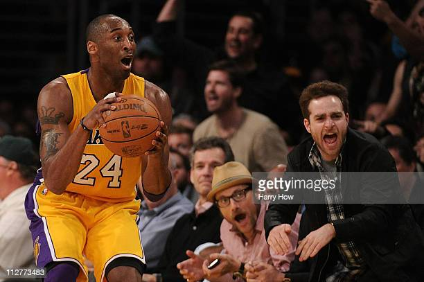 Kobe Bryant of the Los Angeles Lakers reacts on the sideline as do other Lakers fans while taking on the New Orleans Hornets in Game Two of the...