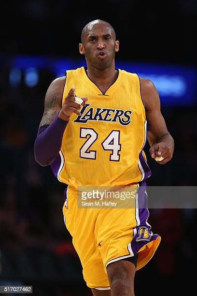 Kobe Bryant of the Los Angeles Lakers reacts to making a basket during the second half of a game against the Memphis Grizzlies at Staples Center on...