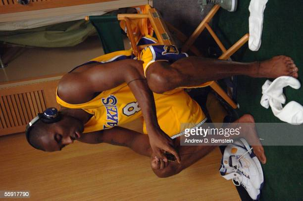 Kobe Bryant of the Los Angeles Lakers readies himself in the locker room against the Golden State Warriors during a preseason game October 11 2005 at...