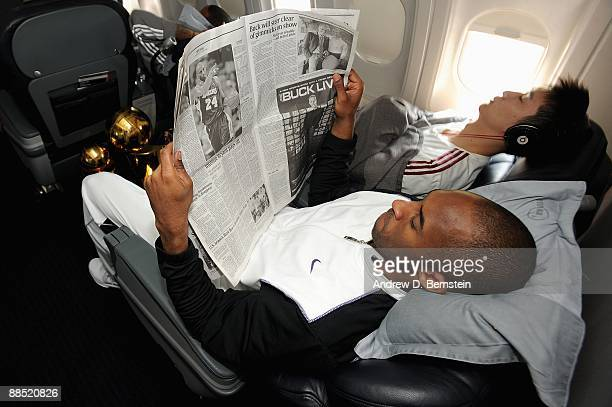 Kobe Bryant of the Los Angeles Lakers reads a newspaper on the team plane on June 15 2009 after the Lakers defeated the Orlando Magic in the NBA...