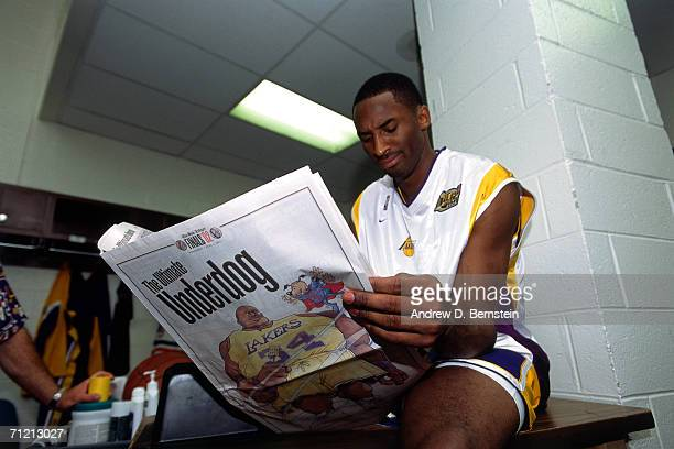 Kobe Bryant of the Los Angeles Lakers reads the papers prior to playing against the New Jersey Nets in a game of the 2002 NBA Finals at Staples...