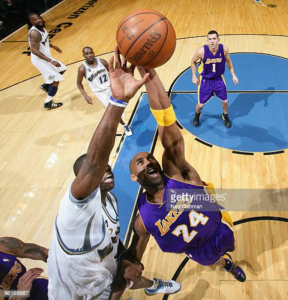 Kobe Bryant of the Los Angeles Lakers rebounds against Antawn Jamison of the Washington Wizards at the Verizon Center on January 26 2010 in...
