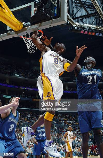 Kobe Bryant of the Los Angeles Lakers rebounds near Kevin Garnett of the Minnesota Timberwolves in Game four of the Western Conference Quarterfinals...