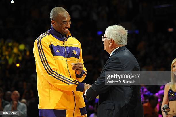 Kobe Bryant of the Los Angeles Lakers receives a championship ring from NBA commissioner David Stern during a ceremony prior to their opening night...