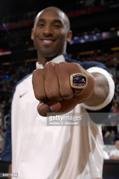 Kobe Bryant of the Los Angeles Lakers receives a ring for being members of the USA Men's Basketball team which won the Gold Medal at the 2008 Beijing...