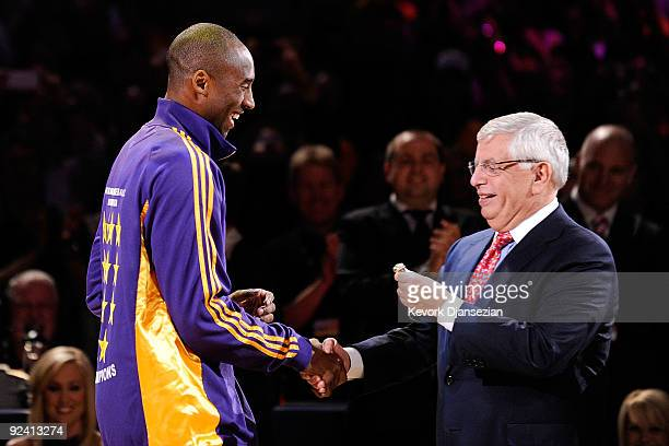 Kobe Bryant of the Los Angeles Lakers receives his championship ring from NBA Commissioner David Stern before the season opening game against the Los...
