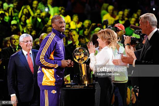 Kobe Bryant of the Los Angeles Lakers receives his championship ring from Executive Vice President of Business Operations Jeanie Buss before the...