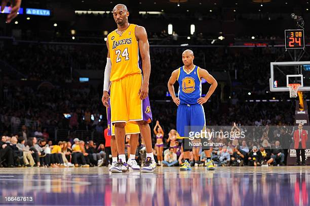 Kobe Bryant of the Los Angeles Lakers returns to the court to shoot freethrows after sustaining an injury during a game against the Golden State...