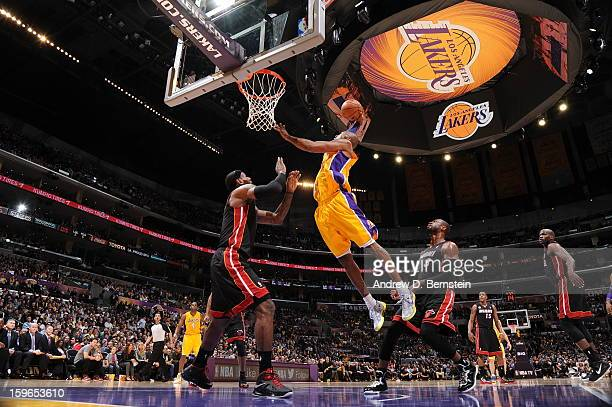 Kobe Bryant of the Los Angeles Lakers rises for a dunk against LeBron James of the Miami Heat at Staples Center on January 15 2013 in Los Angeles...