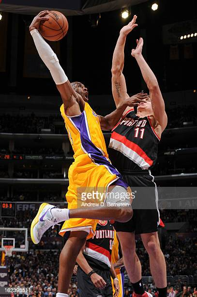 Kobe Bryant of the Los Angeles Lakers rises for a dunk against Meyers Leonard of the Portland Trail Blazers at Staples Center on February 22 2013 in...
